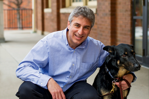 Jaime Modiano. director of the Animal Cancer Care and Research program, with his dog Quetzal.